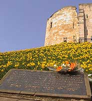 Flowers at Cliffords Tower Jewish memorial